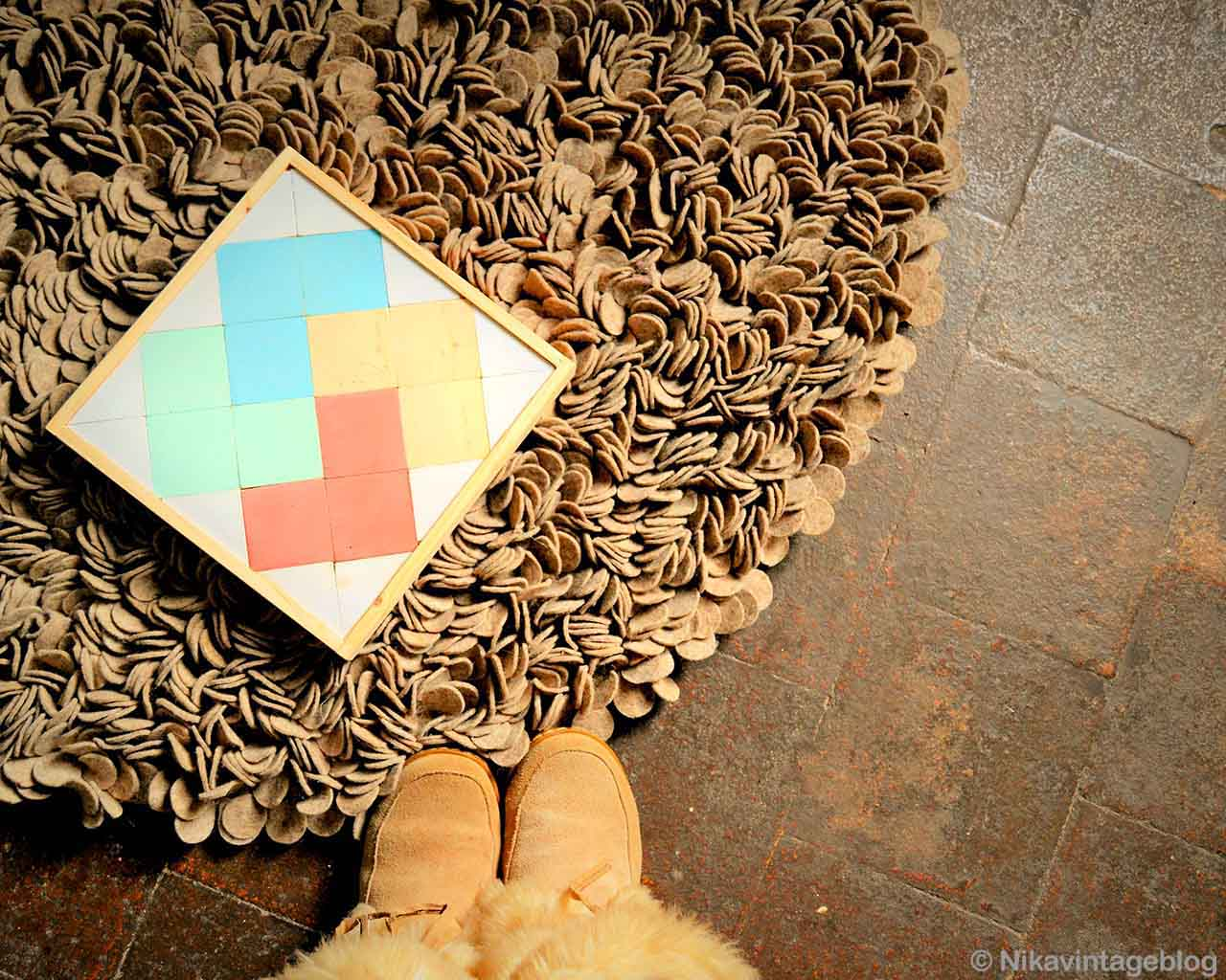 hand knotted brown shoes and photoframe indian brown carpet