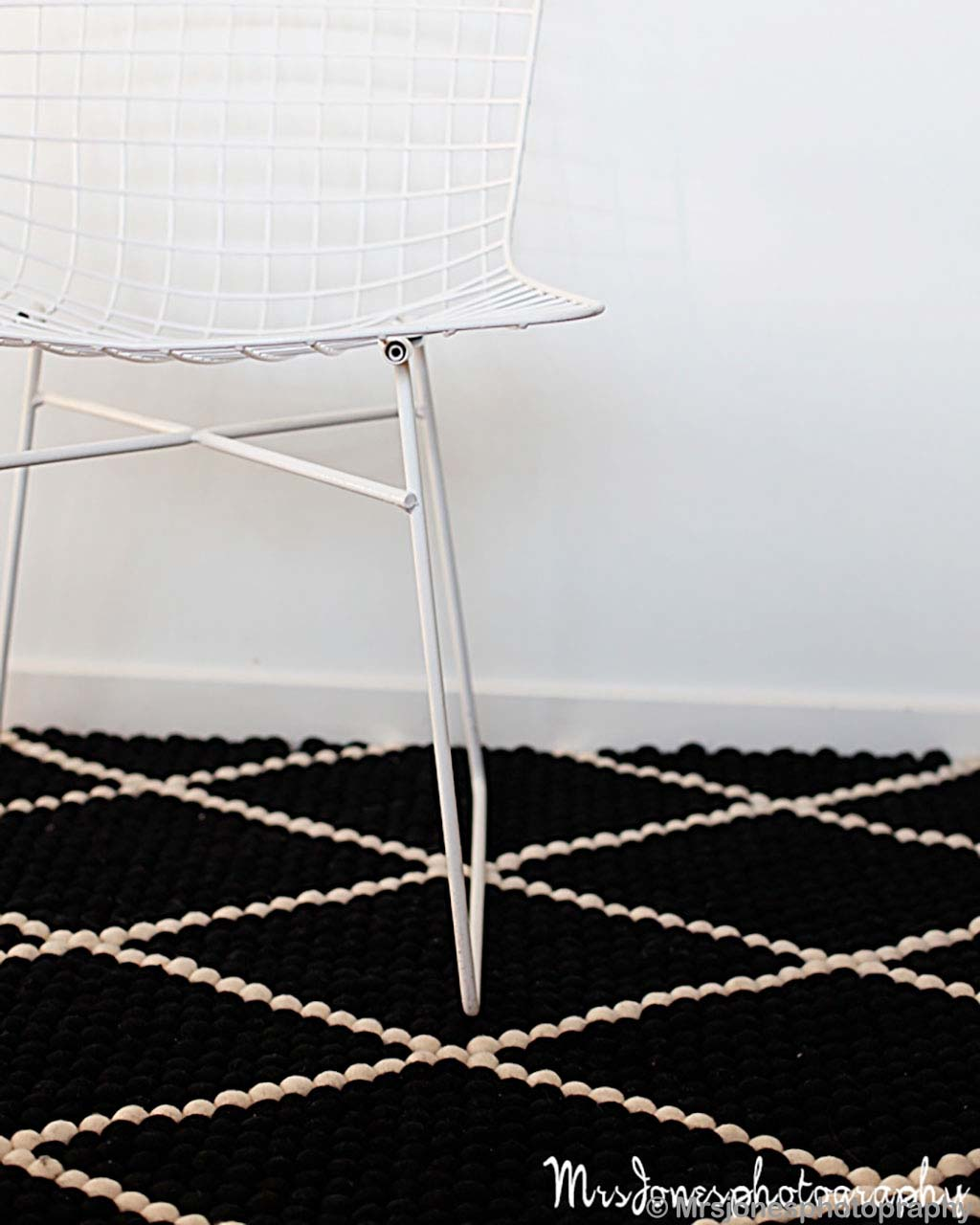 nepal black felt ball with white pattern rugs