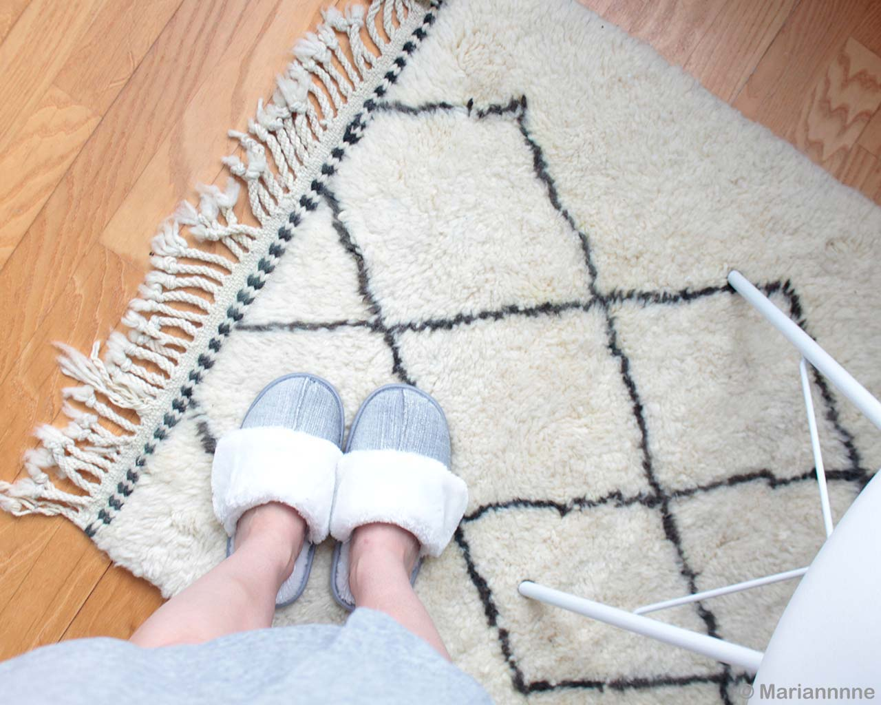 person wearing shoes made in morocco cream rugs