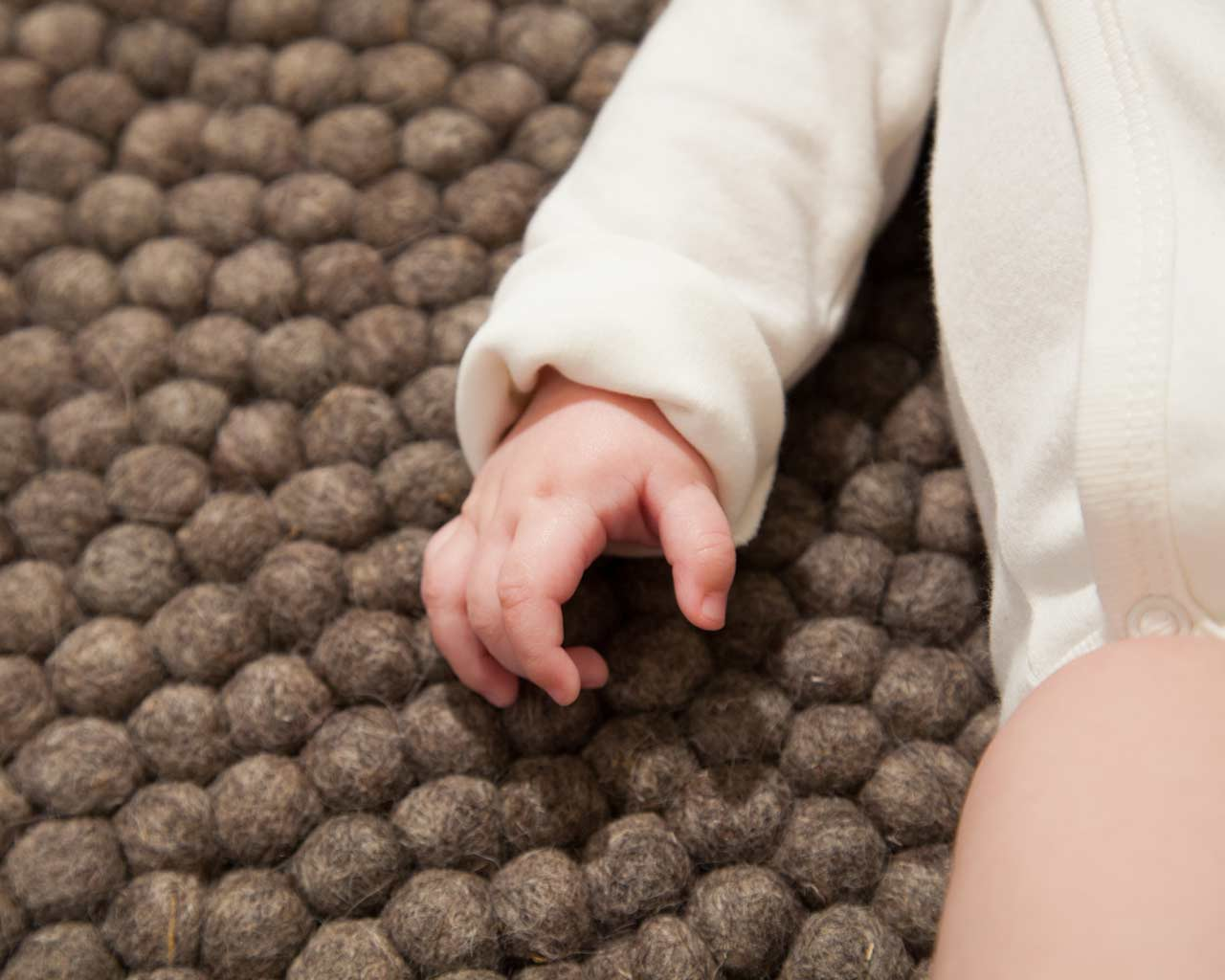 baby clothing brown white felt rug