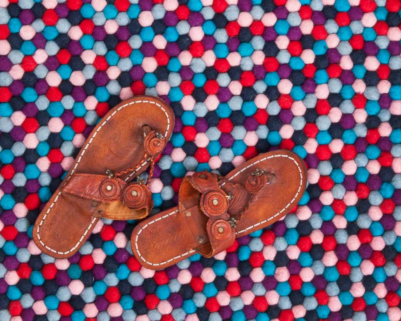 brown leather shoes nepal carpet