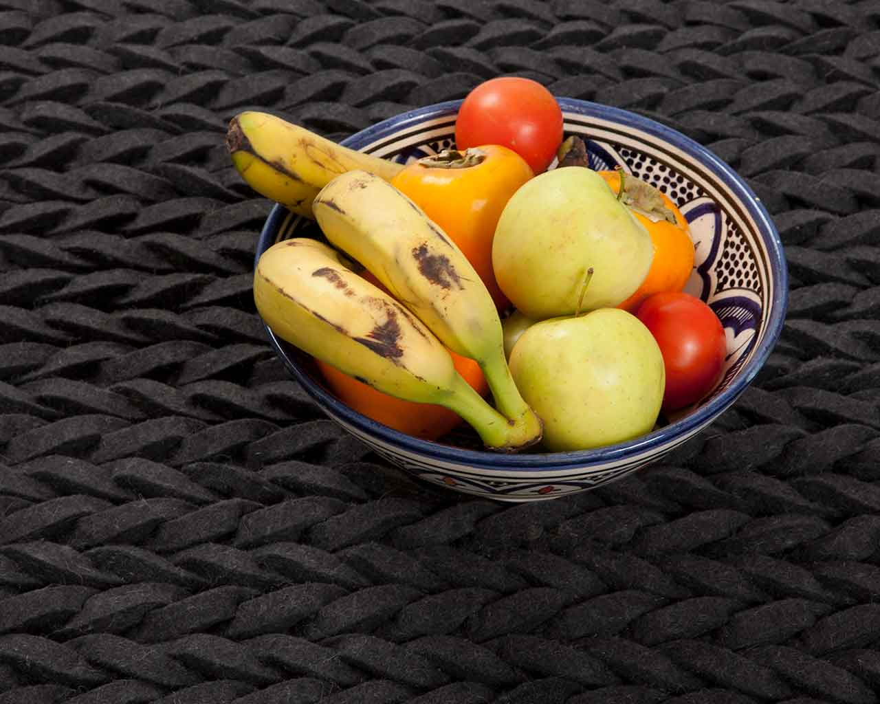 modern fruit still life black carpet 1